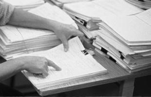 A person reviewing a document