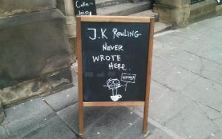 write here write there crosstimers com sign outside cafe in edinburgh saying j k rowling never wrote